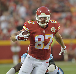 Aug 28, 2015; Kansas City, MO, USA; Kansas City Chiefs tight end Travis Kelce (87) runs the ball during the first half against the Tennessee Titans at Arrowhead Stadium. The Chiefs won 34-10. Mandatory Credit: Denny Medley-USA TODAY Sports