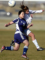 Highland High #3 heads a ball towards a team mate over Lancaster High #5 at Lancaster National Soccer Center for the championship game.  KELLY LACEFIELD/Valley Press Dec 29, 2005