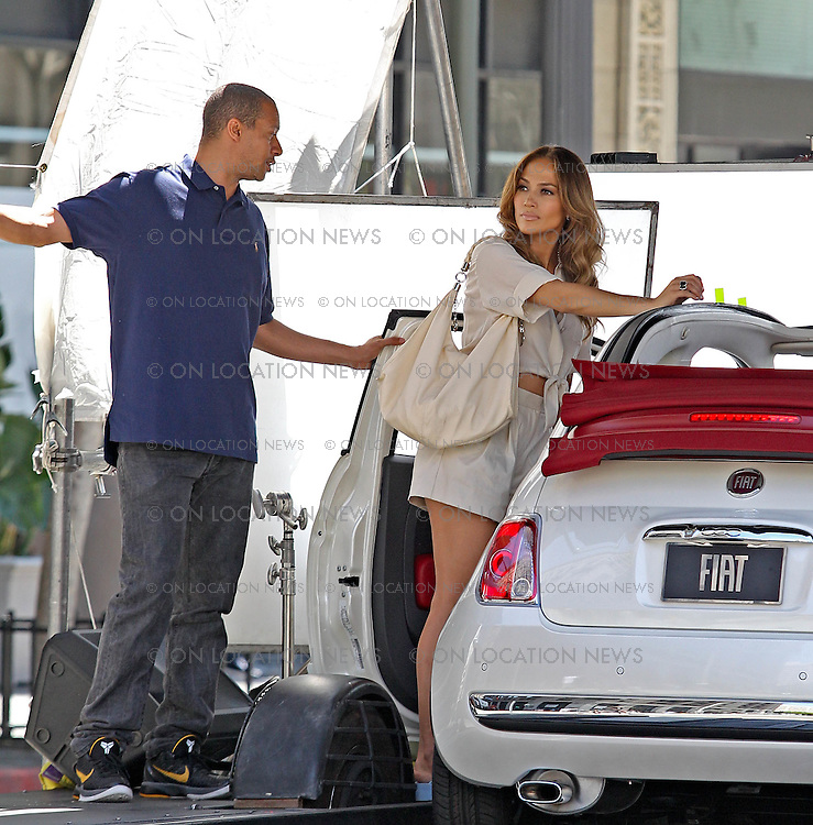 "August 21st 2011 Los Angeles, CA. Non-Exclusive. Jennifer Lopez films a funny music video for her song ""Papi"". JLo filmed several scenes walking down the street and driving away in a Fiat. In every scene there were crowds of Men who were smitten by beautiful JLo. As she walked down the street some men driving cars crash while other men repel down buildings while others jump out of a moving bus all fighting to get to her. As Jlo gets to her Fiat and drives away a massive crowd of men run after her, some bearing flowers and gifts. Photo by Eric Ford / On Location News 818-613-3955 info@onlocationnews.com"