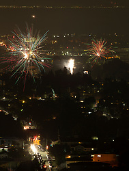 Unauthorized fireworks explode over the Dimond district of Oakland, Calif., as residents celebrate the 242nd anniversary of American independence, Wednesday, July 4, 2018. (Photo by D. Ross Cameron)