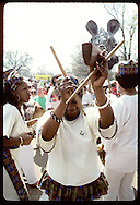 Carib percussionists and dancers march in Earth Day parade at Forest Park in St. Louis. Missouri