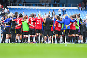Manchester United Women players huddle after the match during the FA Women's Super League match between Manchester City Women and Manchester United Women at the Sport City Academy Stadium, Manchester, United Kingdom on 7 September 2019.