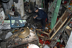 61017759<br /> A rescuer inspects the blast site in northwest Pakistan s Peshawar on Feb. 4, 2014 At least eight people were killed and 25 others injured on Tuesday evening as a blast hit a busy market in Peshawar, local media reported, Tuesday, 4th February 2014. Picture by  imago / i-Images<br /> UK ONLY