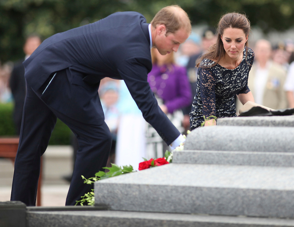 Britain's Prince William and his wife Catherine the Duchess of Cambridge place a wreath at the National War Memorial in Ottawa, Canada,  June 30, 2011, the first stop on their nine-day tour of Canada, kicking off their first official foreign trip as husband and wife.<br /> AFP PHOTO/GEOFF ROBINS