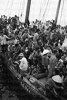 Vietnamese refugees known as the 'boat people' seen crammed on to ships that have arrived off Hong Kong harbour in June 1979 seeking a safe place for refuge. Photograph by Terry Fincher