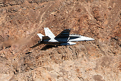 Boeing F/A-18F Super Hornet NH-107 of the US Navy's VFA-154 Black Knights squadron flies low level through the Star Wars Canyon, Jedi Transition, Sidewinder course, Death Valley National Park, California, United States of America