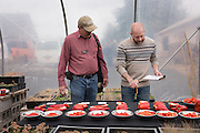 Chef Timothy Wastell reviews the tomato and pepper taste testing with researcher Jim Myers for the Novic Field Day at OSU.
