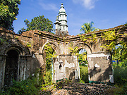 09 NOVEMBER 2014 - SITTWE, RAKHINE, MYANMAR: An abandoned mosque in a Rohingya Muslim neighborhood in central Sittwe, Myanmar. The mosque, and the Rohingya people who used it, were attacked by Buddhist mobs during sectarian violence in 2012. The Rohingya people were forced to move into Internal Displaced Person camps. The mosque and their homes were destroyed. After sectarian violence devastated Rohingya communities and left hundreds of Rohingya dead in 2012, the government of Myanmar forced more than 140,000 Rohingya Muslims who used to live in and around Sittwe, Myanmar, into squalid Internal Displaced Persons camps. The camps are about 20 minutes from Sittwe but the Rohingya who live in the camps are not allowed to leave without government permission. The government says the Rohingya are not Burmese citizens, that they are illegal immigrants from Bangladesh. The Bangladesh government says the Rohingya are Burmese and the Rohingya insist that they have lived in Burma for generations. They are not allowed to work outside the camps, they are not allowed to go to Sittwe to use the hospital, go to school or do business. The camps have no electricity. Water is delivered through community wells. There are small schools funded by NOGs in the camps and a few private clinics but medical care is costly and not reliable.  PHOTO BY JACK KURTZ
