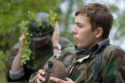 Reenactors from Northern World War Two Association, dressed as panzer grenadiers from the elite Grossdeutschland division, take a break during a private 24hr exercise, held at Sutton Grange, near Ripon in Yorkshire 15  May 2010<br />