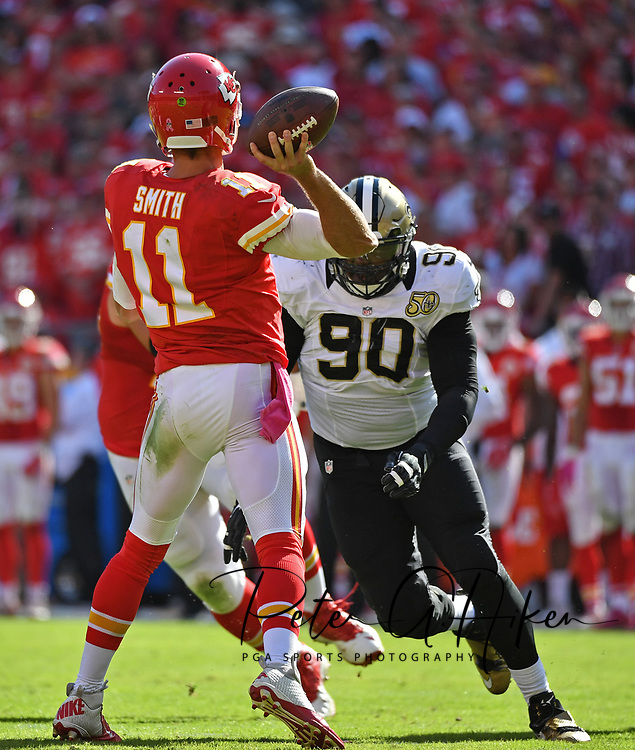 KANSAS CITY, MO - OCTOBER 23:  Defensive tackle Kasim Edebali #90 of the New Orleans Saints closes in on quarterback Alex Smith #11 of the Kansas City Chiefs during the second half on October 23, 2016 at Arrowhead Stadium in Kansas City, Missouri.  (Photo by Peter Aiken/Getty Images) *** Local Caption *** Kasim Edebali;Alex Smith