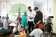 Jason Harris, right, a pediatric infectious disease specialist volunteering with Project HOPE, examines a young cholera patient with a staff doctor at the Hospital Albert Schweitzer on Saturday, October 30, 2010 in Deschapelles, Haiti.