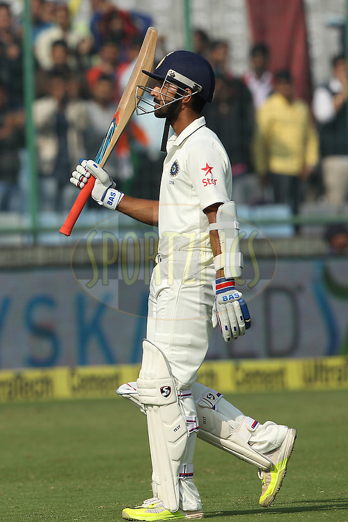 Ajinkya Rahane of India acknowledges the crowd during day two of the 4th Paytm Freedom Trophy Series Test Match between India and South Africa held at the Feroz Shah Kotla Stadium in Delhi, India on the 4th December 2015<br /> <br /> Photo by Ron Gaunt  / BCCI / SPORTZPICS