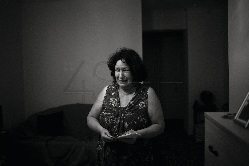 Athens, Greece - Maria Polidis, 62. Her retirement salary is &euro; 425, and house rent is &euro; 350. With an unemployed son living with her, she&rsquo;s already in huge debt. According to Hellenic Statistical Authority, 41.4% of the poor population experience difficulties in dealing with payment arrears such as utility bills for electricity, water, gas, etc. Greek economical crisis started in 2008. The so-called Austerity measures imposed to the country by the &ldquo;Troika&rdquo; (European Union, European Central Bank, and International Monetary Fund) to reduce its debt, were followed by a deep recession and the worsening of life conditions for millions of people. Unemployment rate grew from 8.5% in 2008 to 25% in 2012 (source: Hellenic Statistical Authority). <br /> Bruno Sim&otilde;es Castanheira