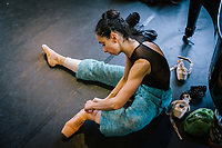 PALERMO, ITALY - 18 FEBRUARY 2018: Romina Leone, a ballerina of Teatro Massimo's Corps de Ballet puts on her ballet in the Sala degli Stemmi (Coat of Arms room) of the Teatro Massimo shortly before the dress rehearsal of the Don Quixote in Palermo, Italy, on February 18th 2018.<br /> <br /> The Teatro Massimo Vittorio Emanuele is an opera house and opera company located  in Palermo, Sicily. It was dedicated to King Victor Emanuel II. It is the biggest in Italy, and one of the largest of Europe (the third after the Opéra National de Paris and the K. K. Hof-Opernhaus in Vienna), renowned for its perfect acoustics. It was inaugurated in 1897.
