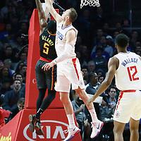 08 January 2018: Atlanta Hawks guard Malcolm Delaney (5) is blocked by LA Clippers forward Sam Dekker (7) during the LA Clippers 108-107 victory over the Atlanta Hawks, at the Staples Center, Los Angeles, California, USA.