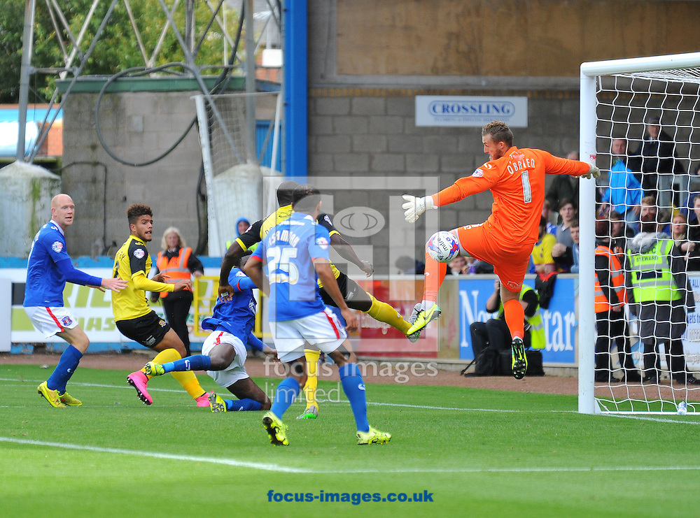 Jabo Ibehre of Carlisle United (third left) heads a match-winning goal during the Sky Bet League 2 match at Brunton Park, Carlisle<br /> Picture by Greg Kwasnik/Focus Images Ltd +44 7902 021456<br /> 12/09/2015
