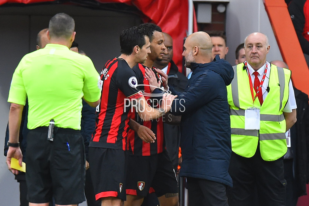 Manchester City manager Pep Guardiola has to hold back Joshua King (17) of AFC Bournemouth after a Bournemouth players was fouled during the Premier League match between Bournemouth and Manchester City at the Vitality Stadium, Bournemouth, England on 2 March 2019.