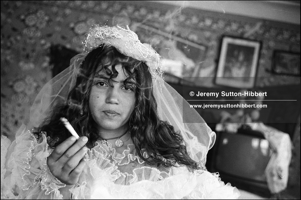 "SOFIA MIHAI, AGED 12, ""MARRIED"" TWICE, AND RETURNED HOME TO LIVE WITH HER PARENTS TWICE. SINTESTI, ROMANIA. MAY 1997..©JEREMY SUTTON-HIBBERT 2000..TEL./FAX. +44-141-649-2912..TEL. +44-7831-138817."