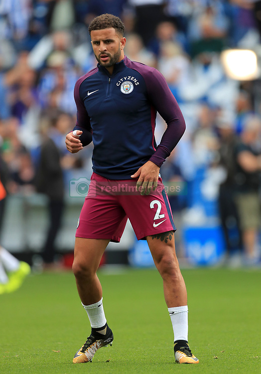 """Manchester City's Kyle Walker warms up prior to the Premier League match at the AMEX Stadium, Brighton. PRESS ASSOCIATION Photo. Picture date: Saturday August 12, 2017. See PA story SOCCER Brighton. Photo credit should read: Gareth Fuller/PA Wire. RESTRICTIONS: EDITORIAL USE ONLY No use with unauthorised audio, video, data, fixture lists, club/league logos or """"live"""" services. Online in-match use limited to 75 images, no video emulation. No use in betting, games or single club/league/player publications."""