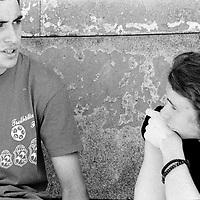 Peja and Milan spend most of their time hanging around..While in Kosovo they may have been able to go to high school, this is a possibility they do not have in the camp...During the summer1999, over 245,000 Serbs and Roms fled to Serbia and Montenegro from or within Kosovo in fear of reprisals from the majority Albanian population, after NATO air strikes had forced the withdrawal of Yugoslav. In 2003, less than 2% of them had returned and a large number of these internally displaced persons (IDPs) were still living in camps in very difficult conditions..In addition, around 5,000 IDPs, mainly of Roma ethnicity, are living in unrecognized collective centres, makeshift huts, corrugated metal containers and other substandard shelters. .This work was meant to look at how the life of children and young adults is affected by the fact that they are IDPs. I asked myself more specifically what would be different for these children/young adults from the 'normal' people of their age as far as education, health, social life, family, 'love' life and leisure are concerned. ..Peja et Milan passe la plupart de leur temps à ne rien faire..Alors qu' au Kosovo ils auraient pu aller au lycée, c'est une option qui n'est plus possible depuis qu'ils vivent dans le camp. ..Pendant l'été 1999, plus de 245 000 serbes et roms ont fuit le Kosovo pour chercher refuge en Serbie ou au Montenegro, par peur de représailles de la part de la majorité de la population albanaise après que les forces de l'OTAN aient forcé l'armée yougoslave à se retirer. En 2003, moins de 2% d'entre eux étaient rentrés chez eux et le plus grand nombre de ces 'déplacés' (IDPs) vivaient encore dans des centres d'accueil dans des conditions très difficiles..Environ 5 000 IDPs, la plupart romas, vivent dans des centres non reconnus faits de containers ou d'abris de fortune. .Ce travail s'est focalisé sur les jeunes IDPs, sur les conséquences de leur état de 'déplacés' sur leur vie et plus particulièrement dans les sphères co