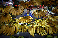 Venezuelan citizen stand on a bananas stand at the Quinta Crespo market in Caracas (Venezuela) Feb. 3, 2009 (Photo/Ivan Gonzalez)