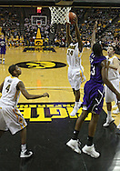 January 12 2010: Iowa Hawkeyes guard Bryce Cartwright (24) puts up a shot during the first half of an NCAA college basketball game at Carver-Hawkeye Arena in Iowa City, Iowa on January 12, 2010. Northwestern defeated Iowa 90-71.