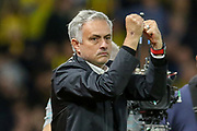 Manchester United Manager Jose Mourinho applauds the fans clenching his fists during the Premier League match between Watford and Manchester United at Vicarage Road, Watford, England on 15 September 2018.