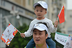 September 13, 2016 - Pingchang, China - A Tour Of China young supporter with his father seen at the start of the fourth stage, 157.57 km from Bazhong to Pingchang, during the 2016 Tour of China 1...On Tuesday, 13 September 2016, in Pingchang, China. (Credit Image: © Artur Widak/NurPhoto via ZUMA Press)
