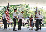Joe Nachazel (third on left), of Viola, works on cutting the 13 stripes of a flag while Gary Yanda, (second on left), of Fairfax, and Steven Shaffer (second on right), of Springville, hold the flag and Tommy Hagensick (third on right), 9, of Springville, holds the cut stripes at the Springville Fire Department in Springville on Saturday, June 9, 2012. The flag disposal ceremony was organized by the Springville American Legion Post. (Stephen Mally/Freelance)