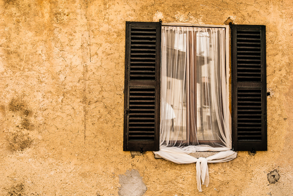 Mesquito netting covers a window on a home in Lavento near Lago Maggiore.