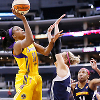 03 August 2014: Los Angeles Sparks forward Nneka Ogwumike (30) goes for the jump shot over Connecticut Sun guard/forward Katie Douglas (23) during the Los Angeles Sparks 70-69 victory over the Connecticut Sun, at the Staples Center, Los Angeles, California, USA.