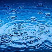 Raindrops on water surface Ray Massey is an established, award winning, UK professional  photographer, shooting creative advertising and editorial images from his stunning studio in a converted church in Camden Town, London NW1. Ray Massey specialises in drinks and liquids, still life and hands, product, gymnastics, special effects (sfx) and location photography. He is particularly known for dynamic high speed action shots of pours, bubbles, splashes and explosions in beers, champagnes, sodas, cocktails and beverages of all descriptions, as well as perfumes, paint, ink, water – even ice! Ray Massey works throughout the world with advertising agencies, designers, design groups, PR companies and directly with clients. He regularly manages the entire creative process, including post-production composition, manipulation and retouching, working with his team of retouchers to produce final images ready for publication.