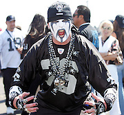 OAKLAND, CA - AUGUST 20:  Oakland Raiders fans pose for a photo while tailgating prior to the game against the San Francisco 49ers at McAfee Coliseum on August 20, 2006 in Oakland, California. The Raiders defeated the Niners 23-7. ©Paul Anthony Spinelli