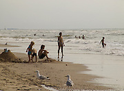 beach scene with parents and children Holland