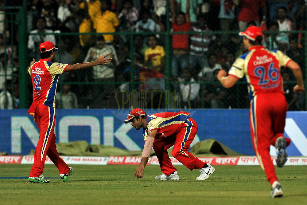 Virat Kholi of Royal Challengers Bangalore takes a catch during match 1 of the NOKIA Champions League T20 ( CLT20 )between the Royal Challengers Bangalore and the Warriors held at the  M.Chinnaswamy Stadium in Bangalore , Karnataka, India on the 23rd September 2011..Photo by Pal Pillai/BCCI/SPORTZPICS
