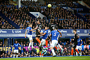 Chelsea defender C?sar Azpilicueta (28) and Chelsea forward Tammy Abraham (9) try to outjump Everton defender Lucas Digne (12) Everton forward Richarlison (7) and Everton defender Michael Keane (5) during the Premier League match between Everton and Chelsea at Goodison Park, Liverpool, England on 7 December 2019.