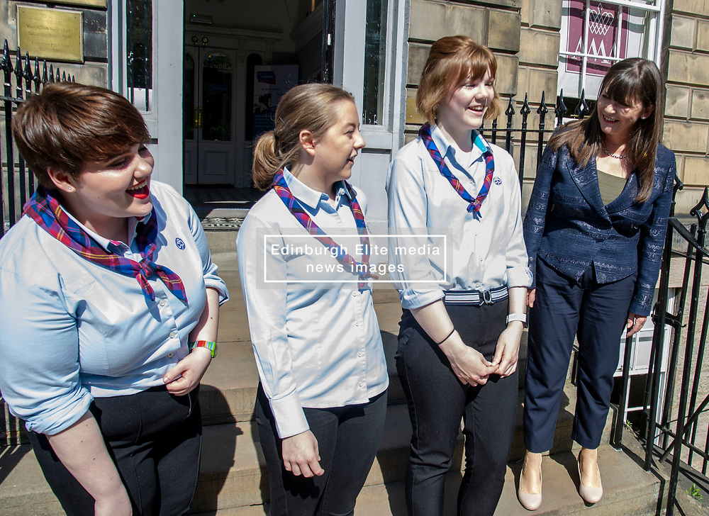 Pictured: Girlguides,  Katie Young, Hannah Brisbane and Katier Horsburgh welcomed the minister toi the GirlGuides Edinburgh Office<br /><br />Mental health minister Claire Haughey joined Girlguiding Scotland Chief Executive officer Denise Spence, Julie Cameron, head of programmes, Mental Health Foundation Scotland and Toni Giugliano, Policy and Public Affairs Manager Mental Health Foundation Scotland  along with some girl guides to discuss the impact of body image on mental health and wellbeing.<br /><br />Ger Harley | EEm 14 May 2019
