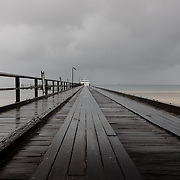 Frazer Island, on the east coast of Australia, is a sand island. Jetty to the ferry during stormy weather. Kingfisher Bay Resort.