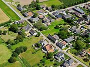 Nederland, Gelderland, Gemeente Buren; 27-05-2020; Rijswijk, de smalle (en steile) Rijnbandijk moest verhoogd en versterkt worden (Na het hoogwater van 1995). Om sloop van de huizen te voorkomen zijn in de dijk damwanden geplaatst en is op de dijk een keermuur aangebracht. om toegang tot de huizen te garanderen zijn ter plaatst coupures – uitsparingen in de keermuur - aangebracht.<br /> Rijswijk, the narrow (and steep) Rhine winterdike needed to be raised and strengthened (after the high water of 1995). To prevent demolition of the houses, sheet piling has been placed in the dike and a retaining wall has been installed on the dike. In order to guarantee access to the houses, denominations - recesses in the retaining wall - have been made on the spot.<br /> <br /> luchtfoto (toeslag op standaard tarieven);<br /> aerial photo (additional fee required)<br /> copyright © 2020 foto/photo Siebe Swart