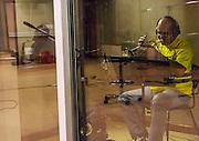 Havana, Cuba,December 18, 2014: Trumpet and flugel player Reinaldo Melian in a booth at Abdala Estudio. Jazz master drummer and singer, Bobby Kapp records at the Abdala Estudio in Havana.  12/16/2014 (Photo: Ann Summa).