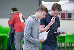 © Licensed to London News Pictures . 20/08/2015 . Salford , UK . CHRISTOPHER ELLIOTT and CHRISTOPHER BIELIUNAS get their results . Students at St Patrick's RC High School in Eccles collect their GCSE results . Photo credit : Joel Goodman/LNP
