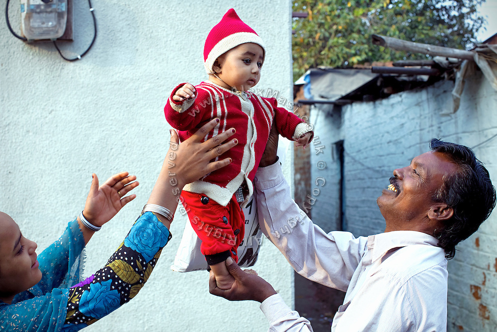 A healthy toddler is being left by his grandfather (right) and his mother, (left) on the streets of New Arif Nagar, one of the water-affected colonies standing next to the abandoned Union Carbide (now DOW Chemical) industrial complex, site of the infamous 1984 gas tragedy in Bhopal, Madhya Pradesh, central India. The poisonous cloud that enveloped Bhopal left everlasting consequences that today continue to consume people's lives.