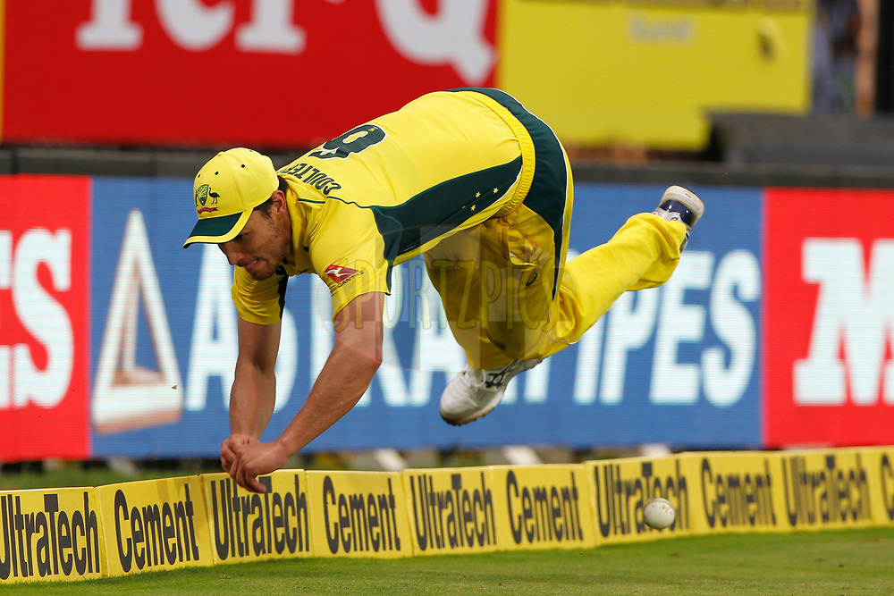 Nathan Coulter-Nile of Australia tries to stop the ball during the 1st One Day International between India and Australia held at the M. A. Chidambaram Stadium in Chennai on the 17th September 2017<br /> <br /> Photo by Deepak Malik / BCCI / SPORTZPICS