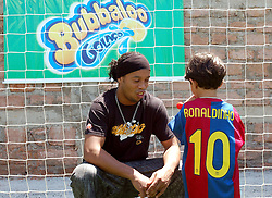 Brazilian superstar Ronaldinho meets students at his own football academy based in Porto Alegre, the Ronaldinho Football Academy (RFA) is run jointly by Ronaldinho?s brother Assif da Silva Moreira, and Ronaldinho?s cousin brother Edmilson. Porto Alegre, Brazil, 27/12/06...