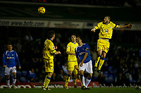 Leeds skipper Kevin Nicholl rises high to head at goal