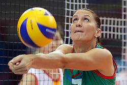 Azerbaijan Yelena Parkhomenko digs a ball