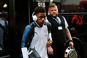 Demarai Gray (7) of Leicester City gets off the team bus wearing Beats headphones on arrival for the Premier League match between Bournemouth and Leicester City at the Vitality Stadium, Bournemouth, England on 30 September 2017. Photo by Graham Hunt.
