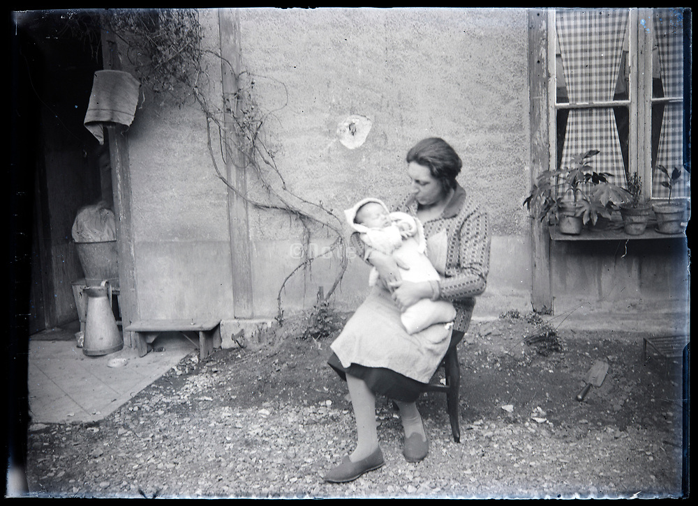 mother holding little baby in her arms France circa 1920s