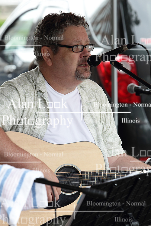 11 July 2015:  Three members including Chris Briggs and Marc Boone (pictured) of the group Marc Boon and the Unknown Legends perform for the festival comers at the 2015 Sugar Creek Arts Festival in Uptown Normal Illinois
