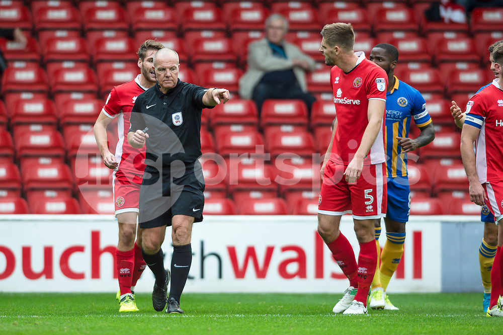 Match Referee Graham Salisbury upholds his decision and awards a penalty to Shrewsbury during the EFL Sky Bet League 1 match between Walsall and Shrewsbury Town at the Banks's Stadium, Walsall, England on 7 October 2017. Photo by Darren Musgrove.